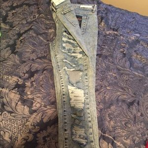 Stretch distressed jeans.